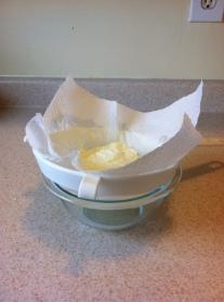 Strain the whey off the yogurt into a bowl