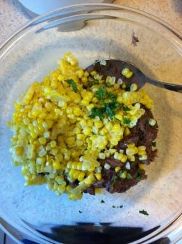 Corn kernels, cilantro, and bean mixture