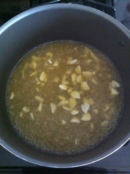 Simmer the garlic in the stock