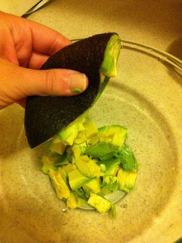 Cut criss-crossed lines in the flesh of the avocado for an easy squeeze out into the bowl