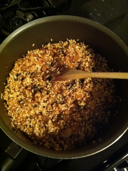 Add the rice and cook it dry for a few minutes.