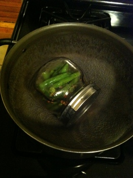 Boil your jar for 5 minutes. Yours should be fully submerged--I just did a bad job...
