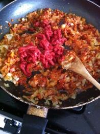 Add the tomato paste...
